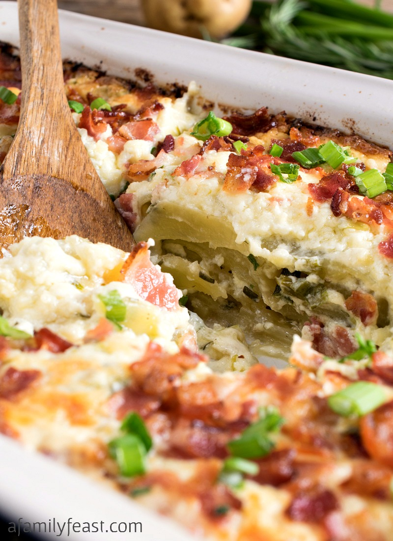 Easy Cheesy Potato Casserole - Tender slices of potato covered with a cheesy, creamy, zesty topping plus bacon and scallions! So good!