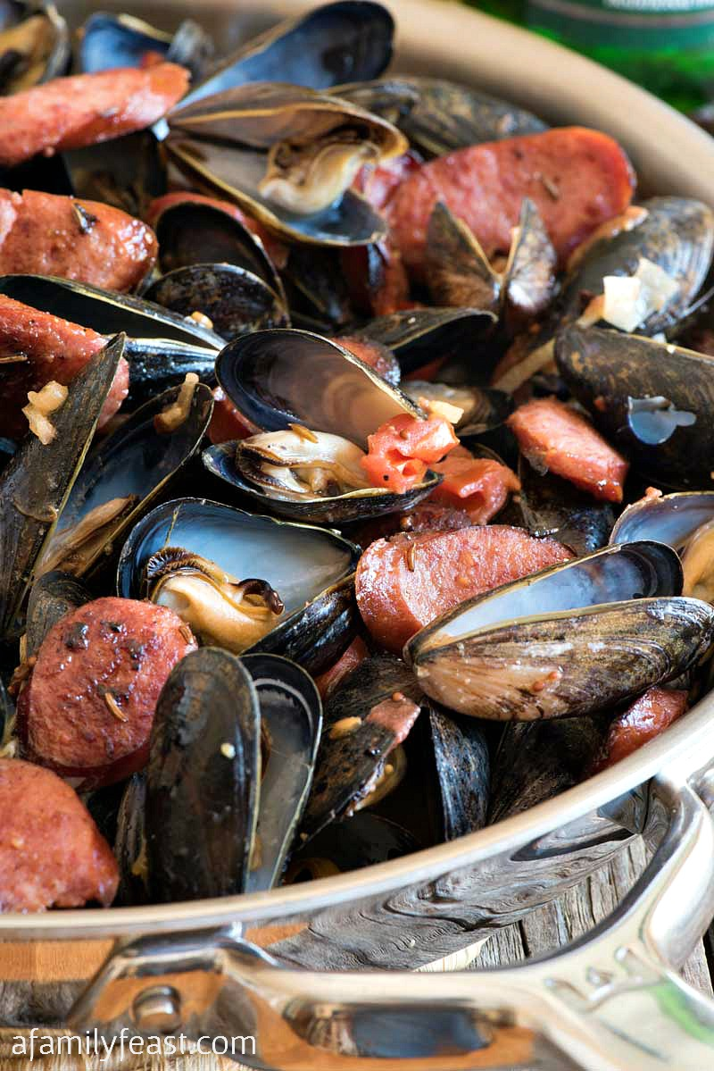 Polish-Style Steamed PEI Mussels - Fresh steamed PEI mussels together with fried kielbasa, shallots, mustard and caraway seed. #PEIMusselsOnTheMenu