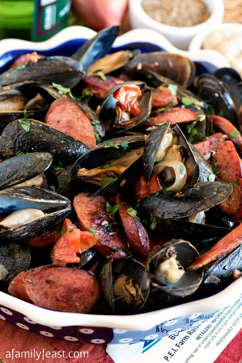 Polish-Style Steamed Mussels - Fresh steamed PEI mussels together with fried kielbasa, shallots, mustard and caraway seed. #PEIMusselsOnTheMenu