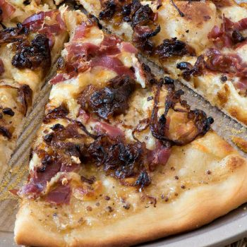 White Barbecue Pizza with Prosciutto and Caramelized Onions - A Family Feast