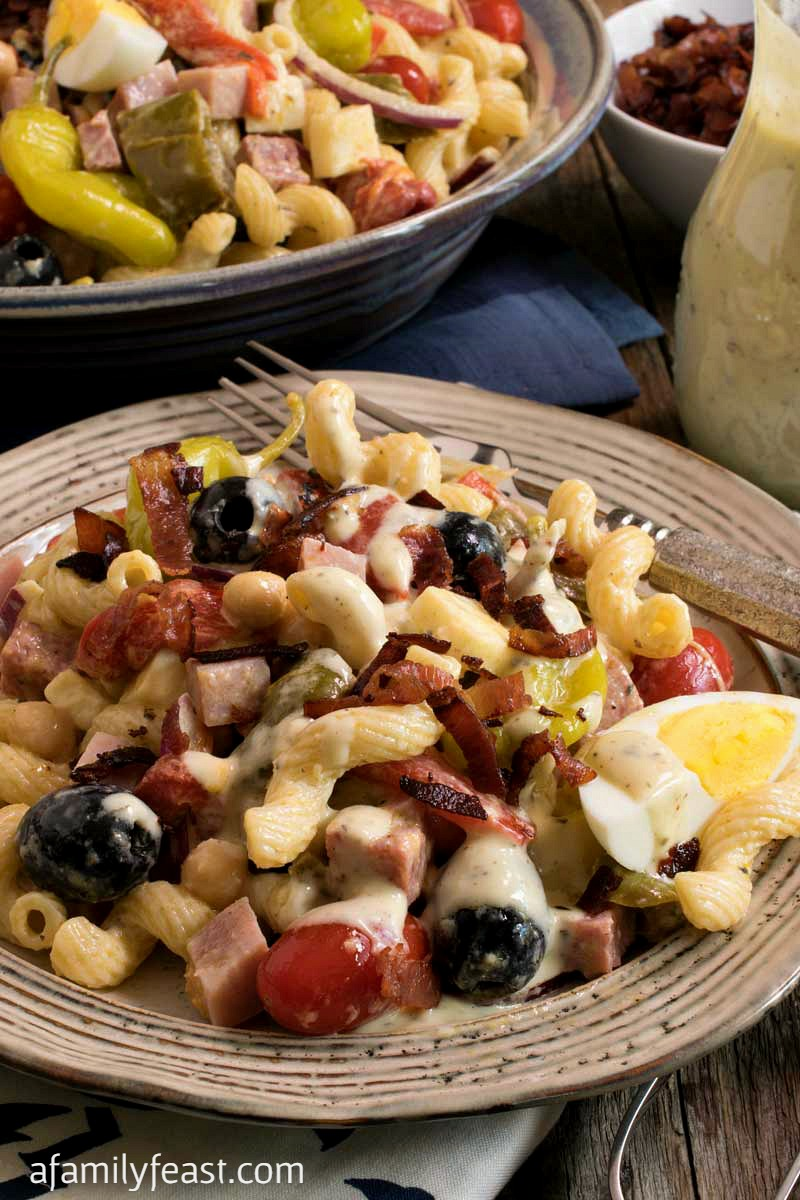 Creamy Italian Pasta Salad - This salad is loaded with pasta, Italian meats, cheese and vegetables and tossed in a creamy Italian dressing. So good