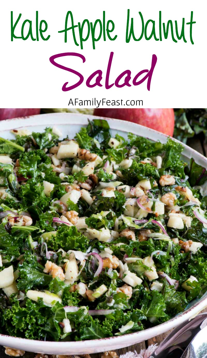 Kale Apple Walnut Salad - Fresh curly kale tossed with apples, walnuts, red onion and cabbage. Such a healthy and delicious salad!