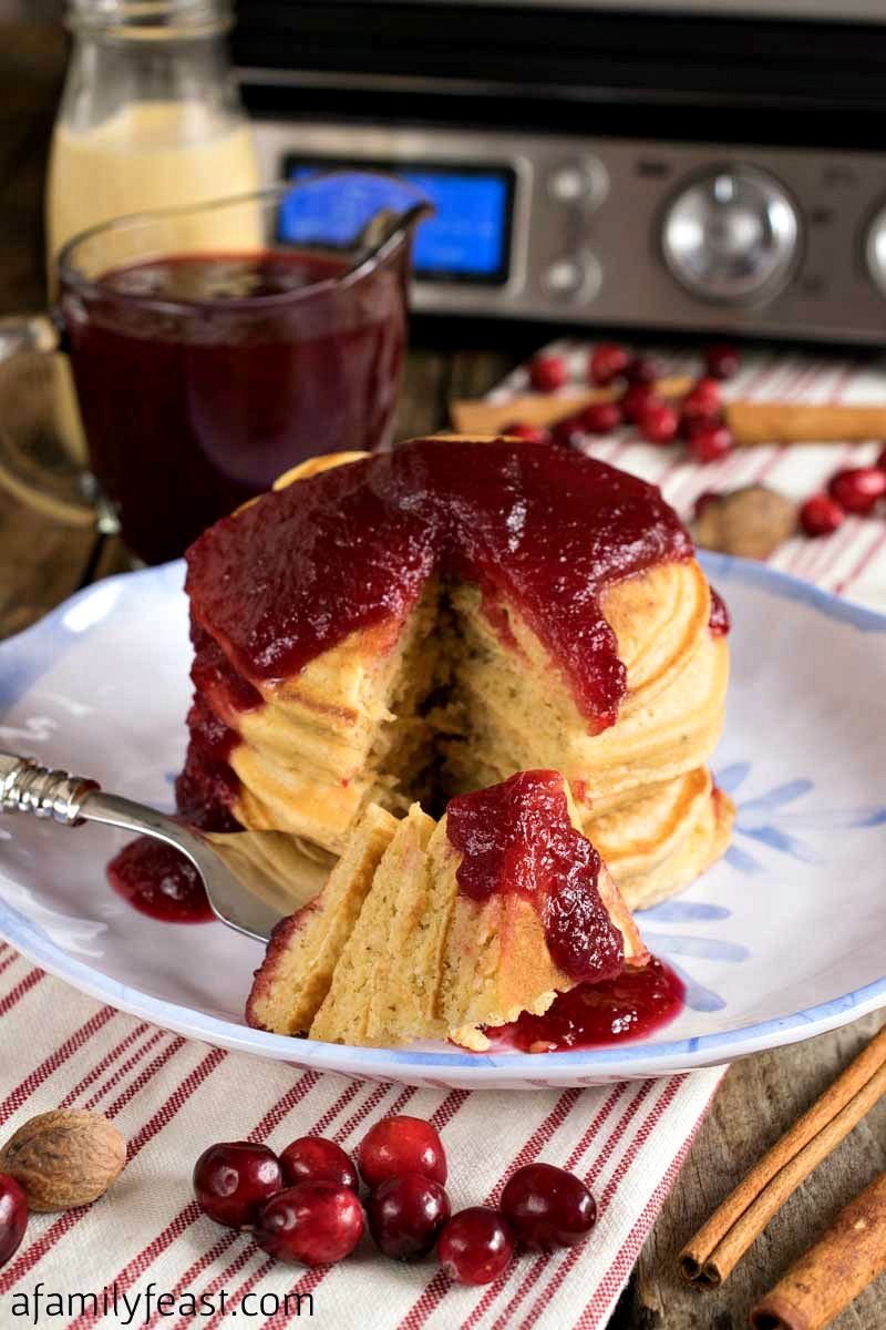 Eggnog Pancakes with Fresh Cranberry Syrup is a wonderful holiday breakfast the entire family will love!t