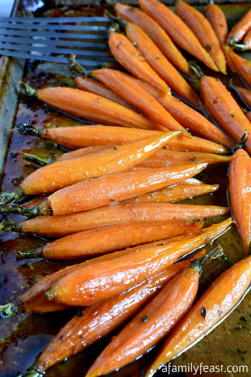 Cider Glazed Carrots - Apple cider, brown sugar, mustard and thyme create a simple, tasty carrot side dish that is the perfect addition to any meal!